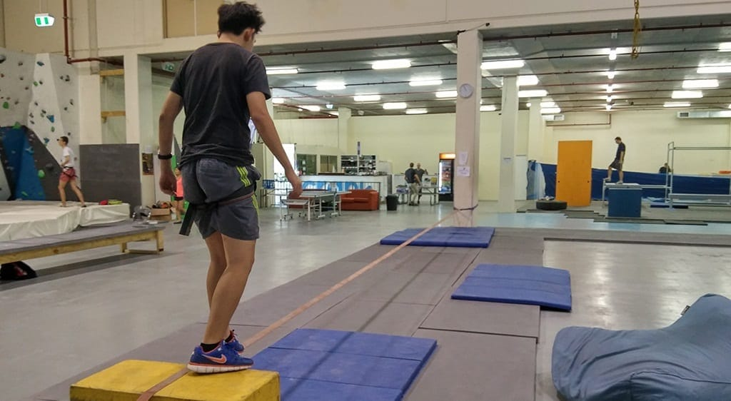walking the slackline at Crank Indoor Climbing