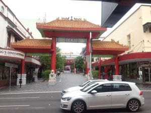 Entrance to chinatown in fortitude valley. traditional chinese roofs on pillars.