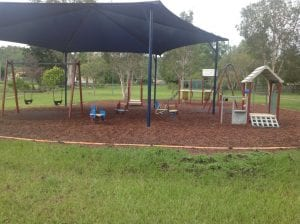 Keppera playground, covered by mesh shade. swingset, spring rocking chairs for kids and slide.
