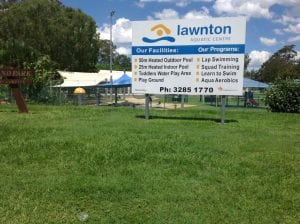 lawnton aquatic centre sign in front of playground