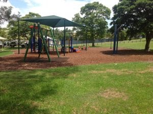 northgate park with swingset , seesaw and other balance equipment.