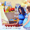 pregnant women choosing cot for new baby