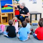 photo credit Tricia King Photography, www.triciaking.com.au - kids in kindy listening to teacher