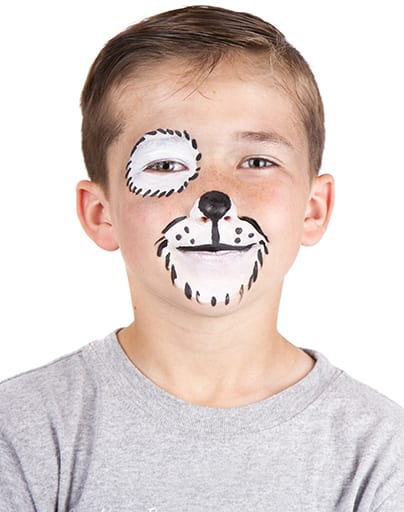 Young boy wearing dog carnival face paint isolated on white
