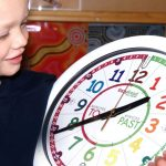 young boy reading time on an EasyRead clock
