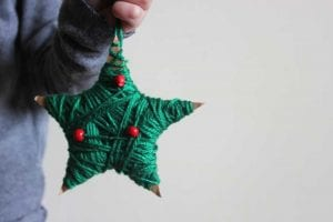 DIY Star Ornament Featured Image, child holding star ornament final product