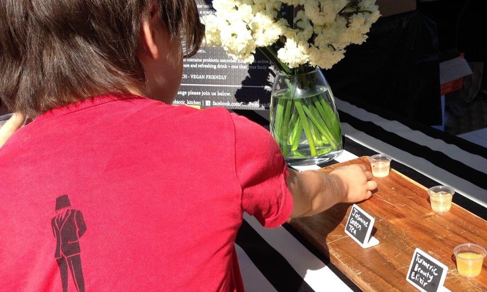 Boy shopping at Bundall Farmer's Market for Kids