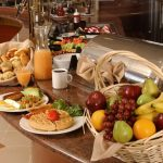 Mother's day ideas - stock buffet breakfast - waffles, fruit, english breakfast, muffins, bread