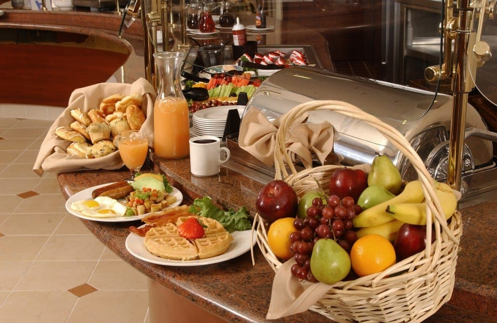 stock buffet breakfast - waffles, fruit, english breakfast, muffins, bread