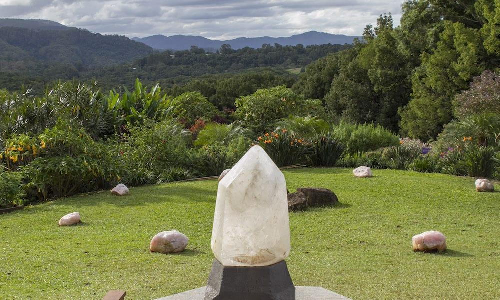 Crystal Castle Byron Bay gardens and large quartz crystal