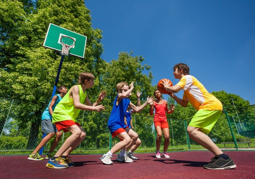 Basketball for kids - kids playing baketball on a bright day