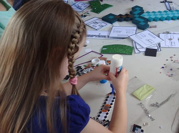 Girl crafting a sword at the Minecraft Party Crafting Table