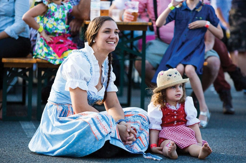 Mother and Daughter looking off into the distance in german clothing - festivals Brisbane