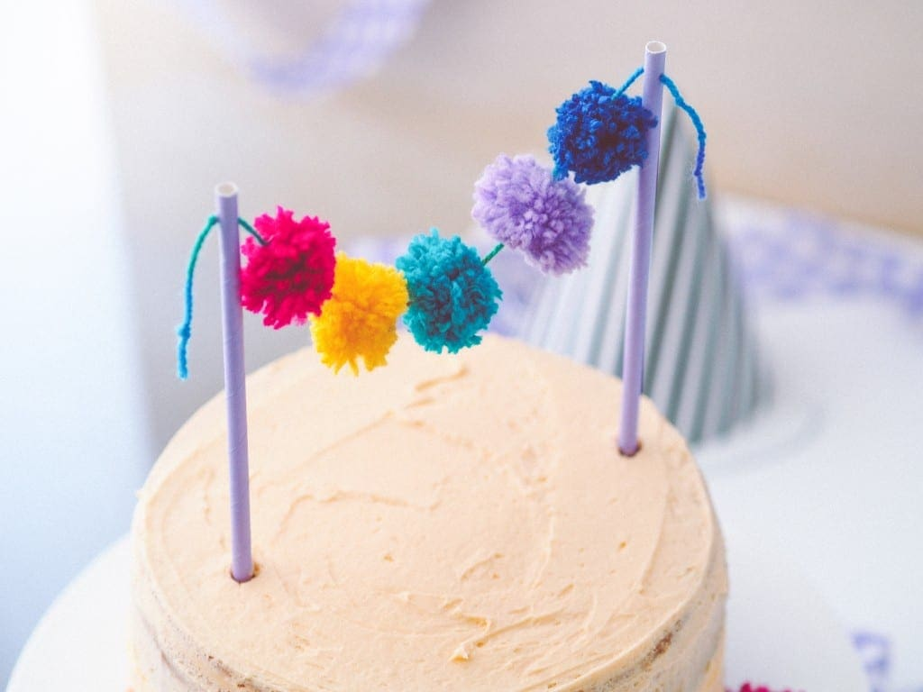 Cute and Colourful Pom Pom Cake Topper on cake