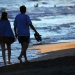 date night ideas gold coast romantic couple on beach evening stroll