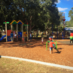 Paradise Point Park is a shady oasis of sun speckled park space located next to the Broadwater - perfect for a family day of swimming and park fun.