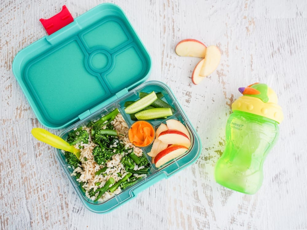 Lunch box Inspiration salad and apple in lunchbox with drink bottle