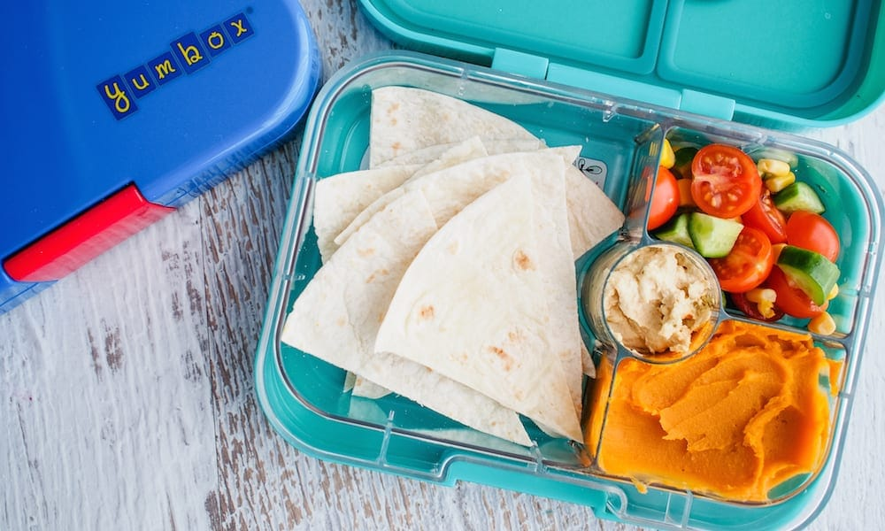 Lunch box Inspiration bread, dip and apple in open lunchbox