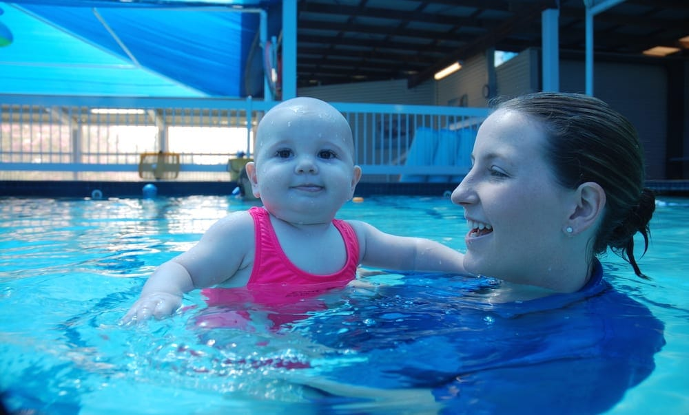 Emma Lawrence and child in pool