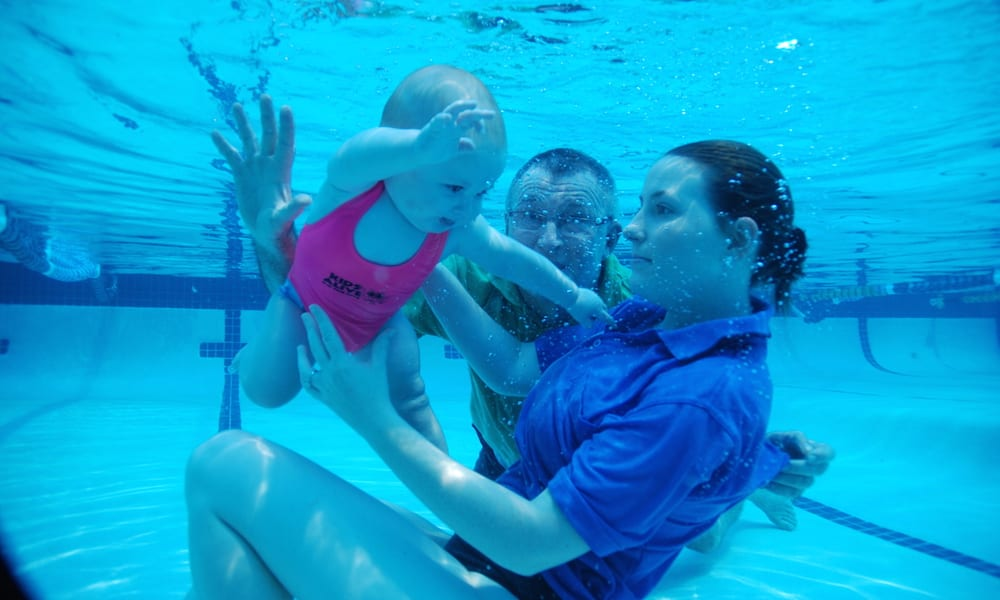 Emma Lawrence, Laurie Lawrence and child in pool