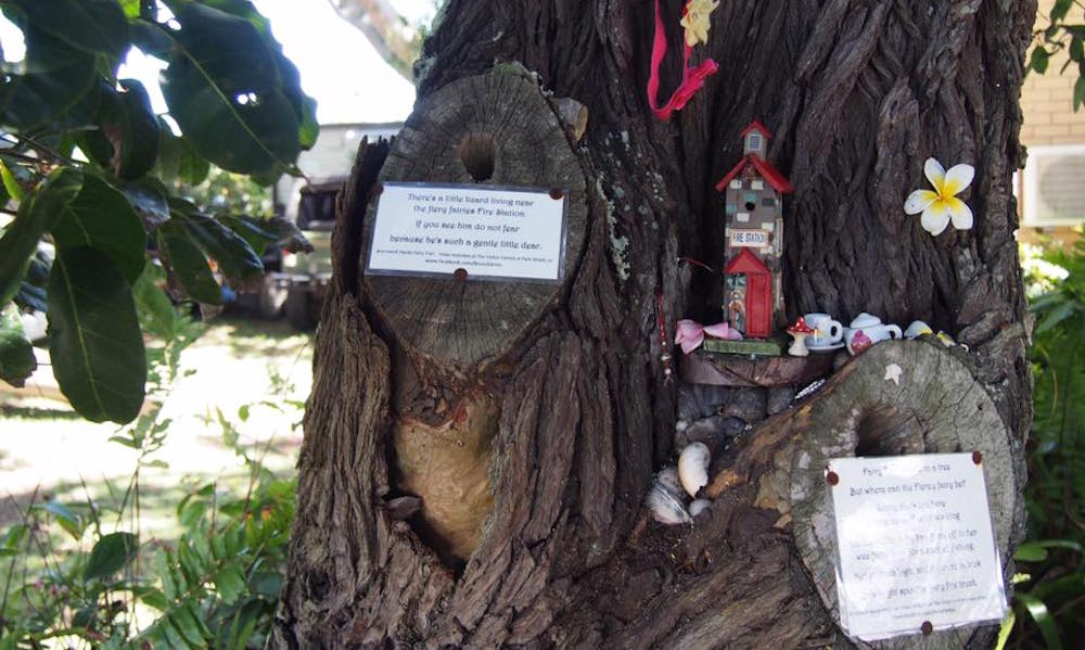 Miniature fairy fire station hidden in a tree