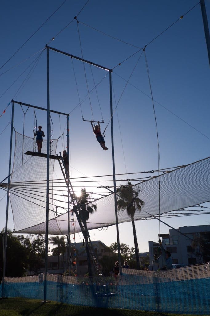 Circus Arts Trapeze dusk image of children learning trapeze outside