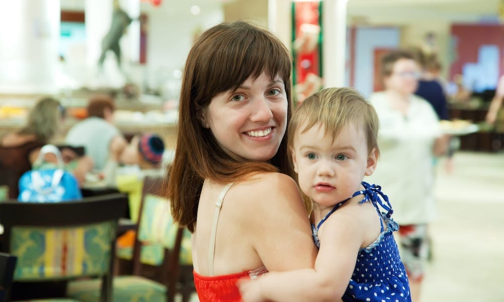 Happy mother with child at cafe