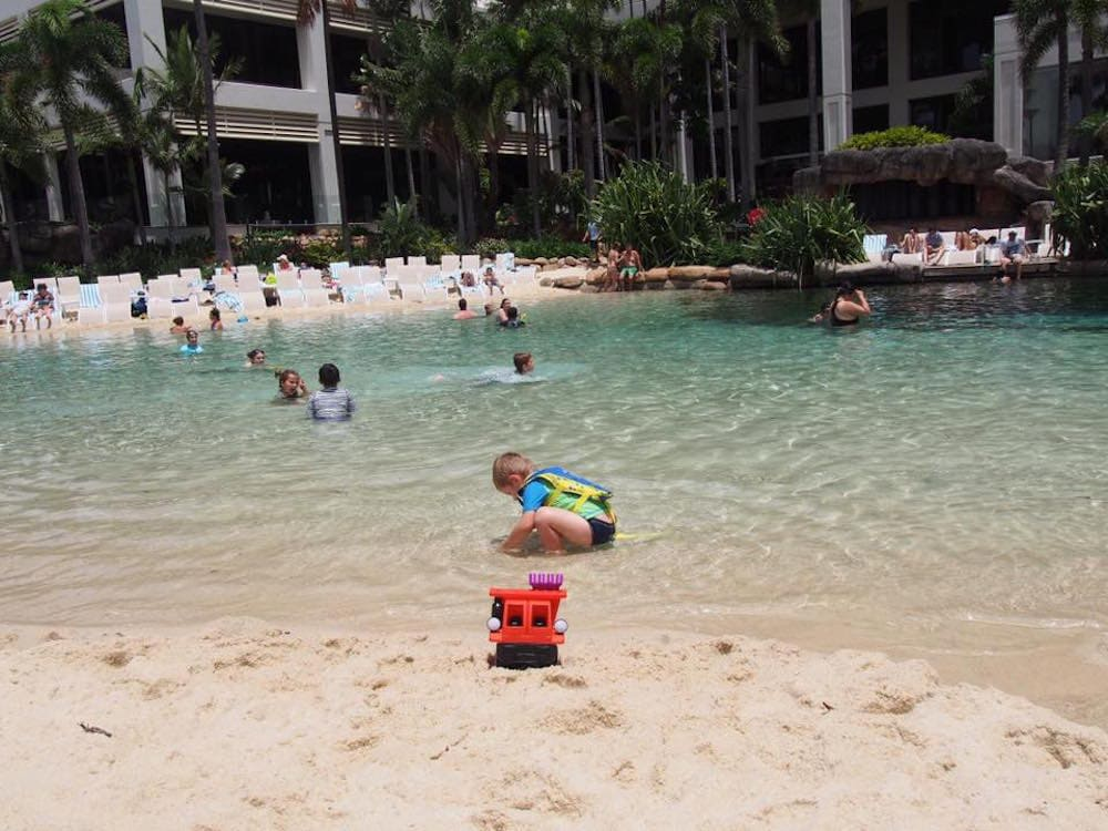 Small child playing in lagoon pool at Surfers Paradise Marriott Resort & Spa