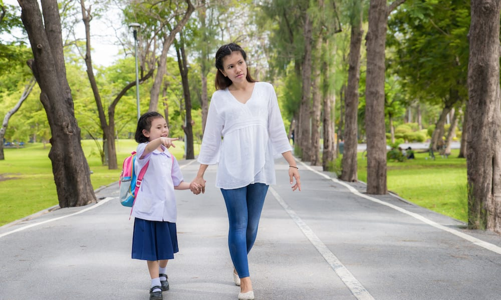 Open Days for Schools Asian mother and daughter student walking to school.Pupil student.