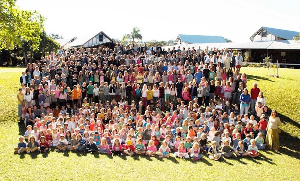 Shearwater Steiner School all students and teachers in a group photo on school oval