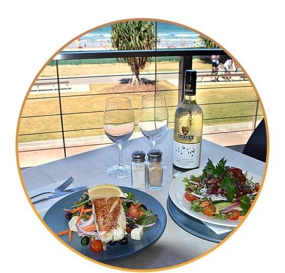 Soutport SLSC Family Friendly Surf Clubs on the Gold COast picture of table set up with wine glasses and dining in summer