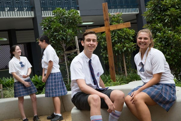 Aquinas College Parent Fact Sheet students in uniform sitting outside school smiling
