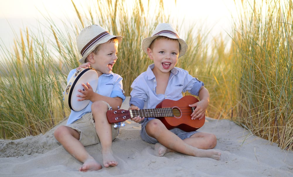 Music Brain two little boys playing instruments on the beach