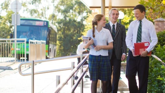Students and teacher walking through school grounds Somerset College image