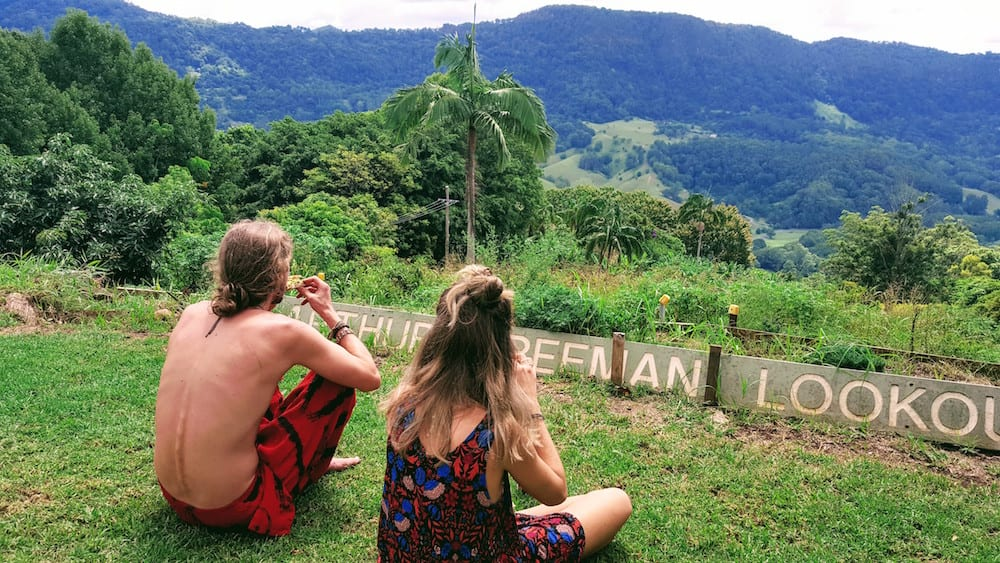 Freeman's Organic Farm couple sitting on grass looking out at view
