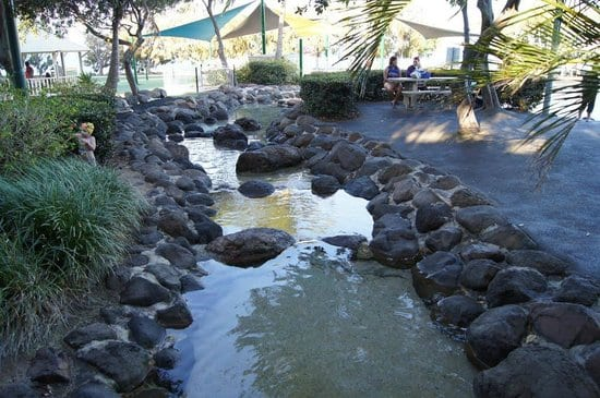 Settlement Cove seating and artificial rocky stream