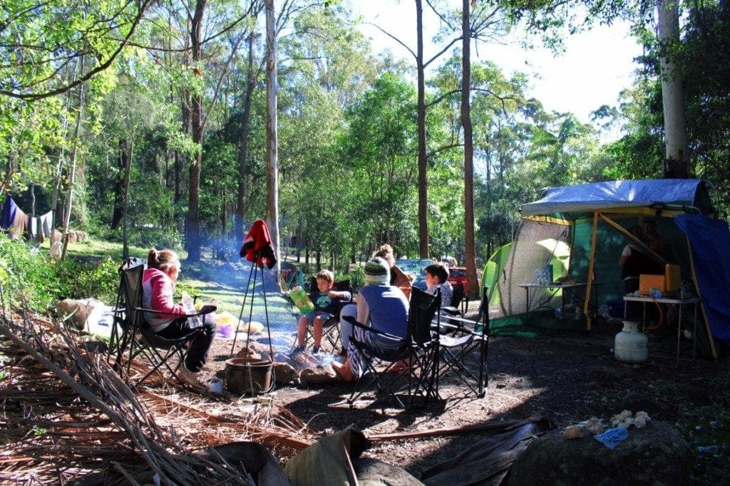 Thunderbird Park campers in front of fire - family attractions