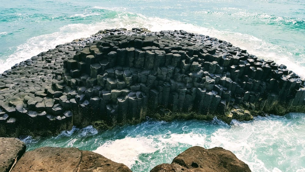 Fingal Head Lighthouse family observing lava rock formation