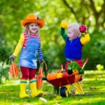 Gardening with children - two toddlers on a farm