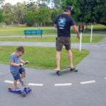 Father and child on boards at Galleon Way Bike Park