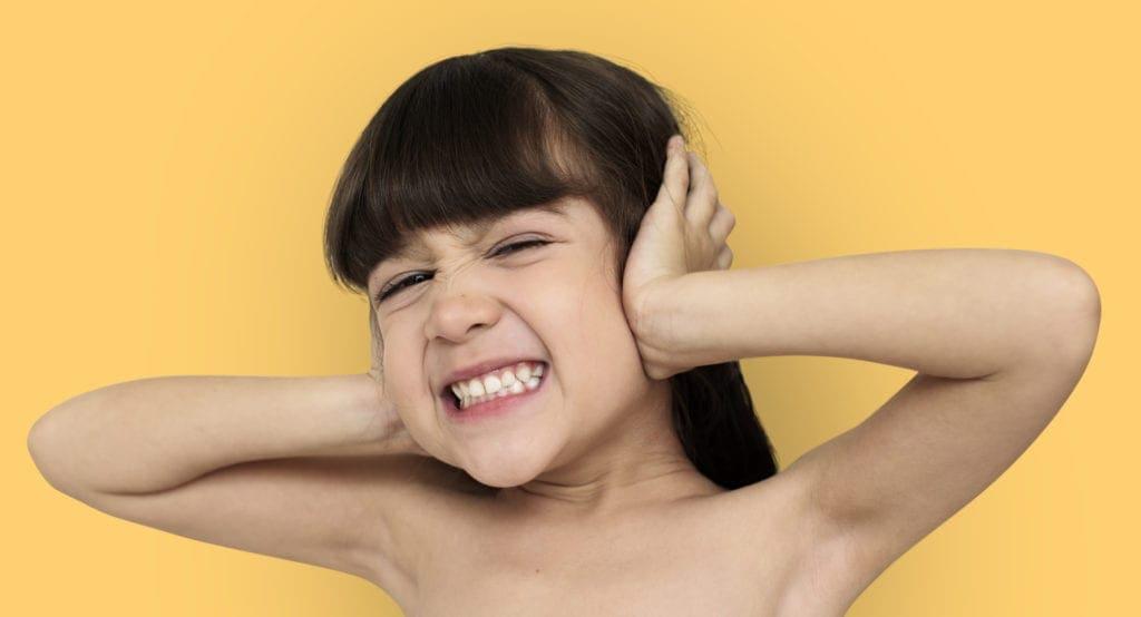 Little Girl Covering Ears overwhlelmed and melting down