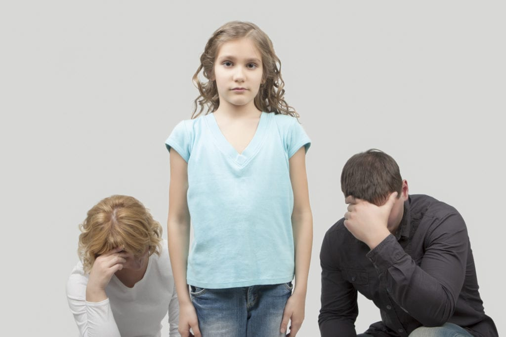 father and mother misunderstand their teenage girl standing separated from each other needed support