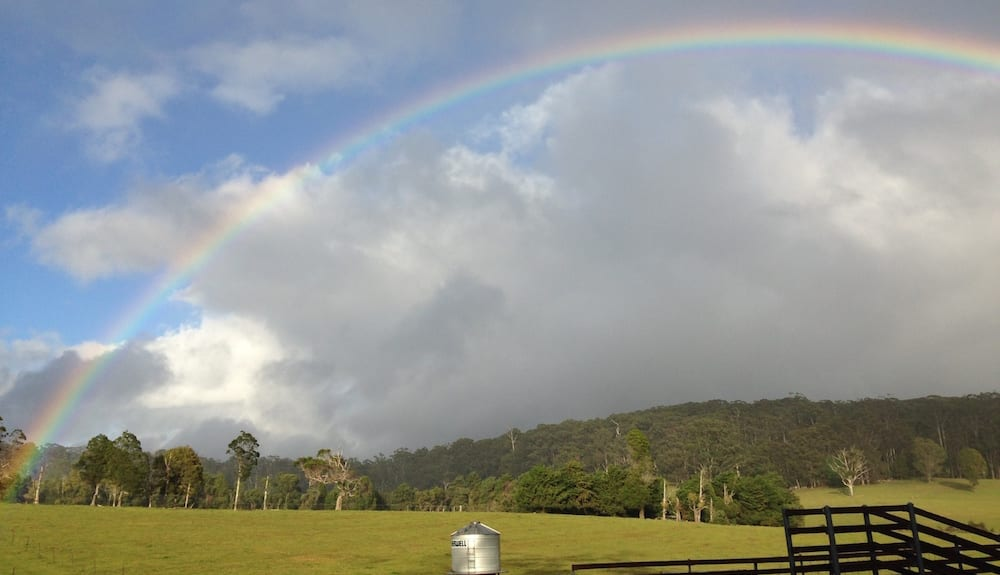 rainbow over field Farm stay gold coast