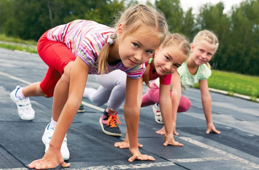 Gold Coast School Holidays three pre-teen girls starting to run on track