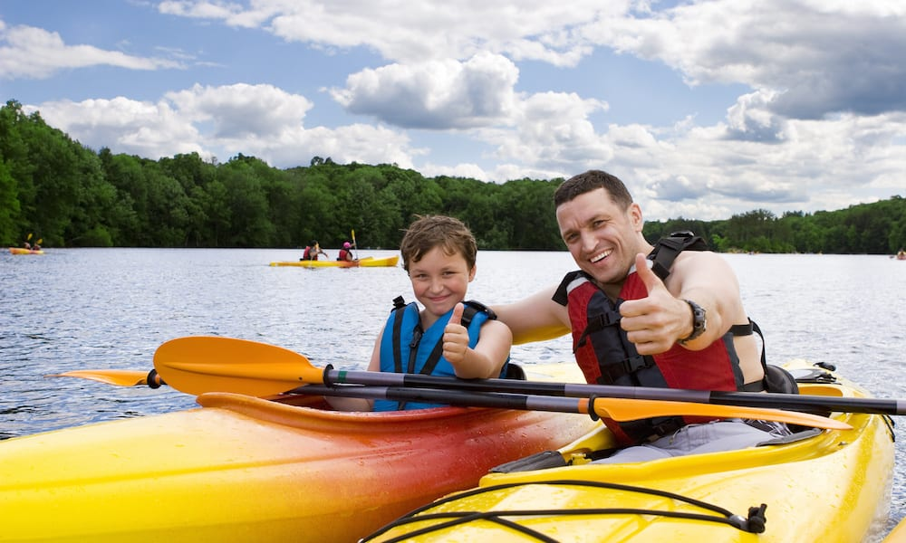 Family Friendly Camping Murwillumbah Father and son enjoying kayaking