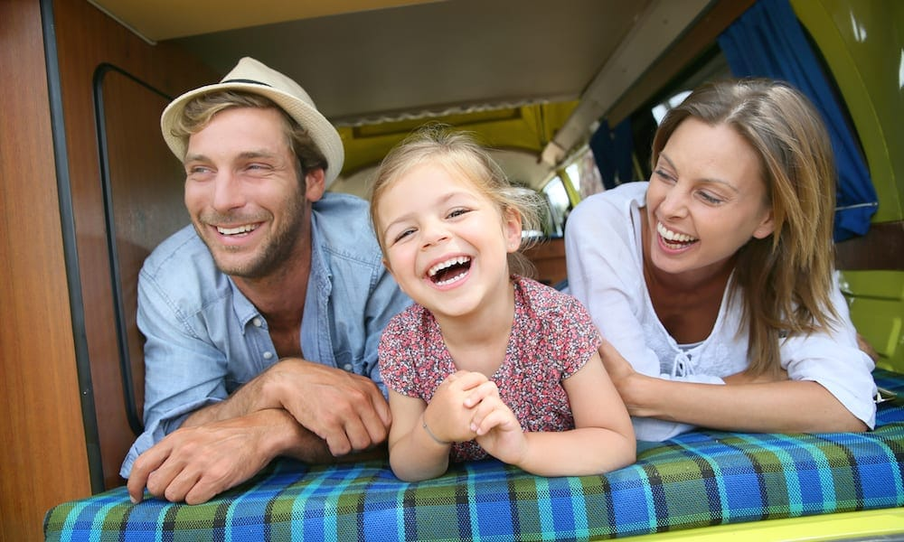 Portrait of cheerful family having fun in camper Family Friendly Camping Murwillumbah