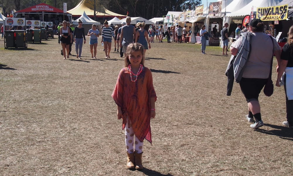 Little girl standing in the crowd at Splendour in the Grass