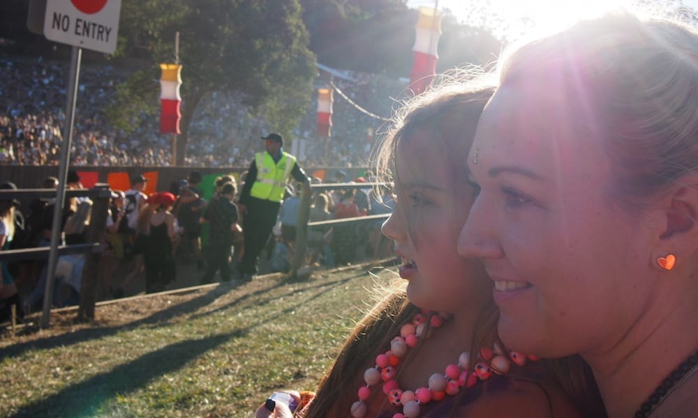 Woman and child enjoy watching the entertainment at Splendour in the Grass