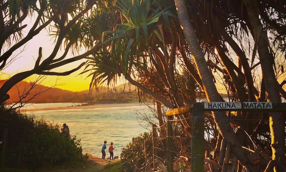 Little boys playing in coastal beach sunset Tweed Coast Holiday