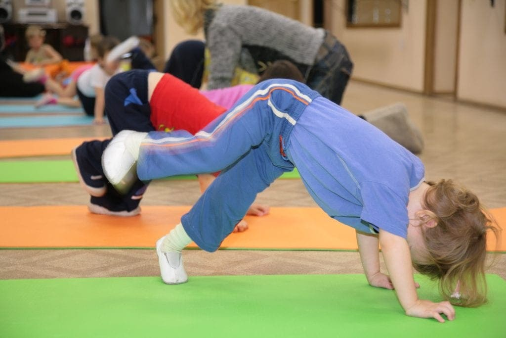 young girl engaged in gymnastics encouraging your child